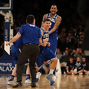 Jaren Sina, (left) and Brandon Mobley, Seton Hall,  celebrate their win during the Villanova Wildcats Vs Seton Hall Pirates basketball game during the Big East Conference Tournament at Madison Square Garden, New York, USA. 12th March 2014. Photo Tim Clayton