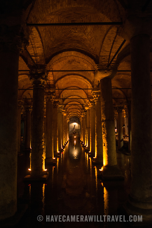 The Basilican Cistern is located in the historical peninsular of Istanbul in the Sultanahment district. It was built in the 6th century during the reign of Justinianus. It's 140 metres long and 70 metres wide. There are 336 marble columns, each 9 metres high, arranged in 12 rows of 28 columns. Most are in the ionic and Corinthian styles, although a few are Doric style. The water comes from the Belgrade Woods, 19 kilometres north of the city, transported by aqueducts. Among Roman age art sculptures are two Medusa's heads carved into columns.