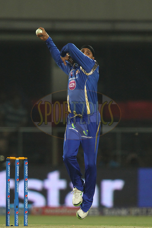 Harbhajan Singh of Mumbai Indians sends down a delivery during match 21 of the Pepsi IPL 2015 (Indian Premier League) between The Delhi Daredevils and The Mumbai Indians held at the Ferozeshah Kotla stadium in Delhi, India on the 23rd April 2015.<br /> <br /> Photo by:  Shaun Roy / SPORTZPICS / IPL