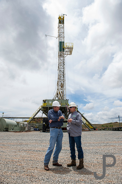 Congressman Frank Lucas talks to Cactus Drilling foreman Roland Carroll at Rig 114 while it was drilling north of Cheyenne, OK.