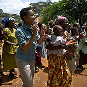 Helene Gayle, CEO and President of CARE dances with members of the Barracka HIV/AIDS support group in South Alego village. The group is comprised of 35 women and 15 men who are HIV positive who have come together to support each other and help reduce HIV prevalence in the community.