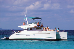 Tourists sunbathing on the deck of catamaran near to Guardalavaca; Holguin province; Cuba,