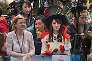 A japanese tv presenter gets into the mood of the film - Alice Through the Looking Glass premiere - a Walt Disney American fantasy adventure film directed by James Bobin, written by Linda Woolverton and produced by Tim Burton. It is based on Through the Looking-Glass by Lewis Carroll and is the sequel to the 2010 film Alice in Wonderland. The film stars Johnny Depp, Anne Hathaway, Mia Wasikowska, Rhys Ifans, Helena Bonham Carter, and Sacha Baron Cohen and features the voices of Alan Rickman, Stephen Fry, Michael Sheen, and Timothy Spall.