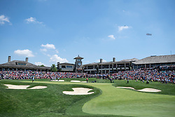 June 3, 2018 - Dublin, OH, U.S. - DUBLIN, OH - JUNE 03:  The final group of Bryson DeChambeau, Patrick Cantlay, and Kyle Stanley on the eighteenth green surrounded with spectators with the clubhouse in the background during the final round of the Memorial Tournament at Muirfield Village Golf Club in Dublin, Ohio on June 03, 2018. (Photo by Shelley Lipton/Icon Sportswire) (Credit Image: © Shelley Lipton/Icon SMI via ZUMA Press)