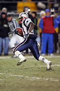 PITTSBURGH - JANUARY 23:  Wide receiver Deion Branch #83 of the New England Patriots scores on a 23 yard touchdown run in the fourth quarter against the Pittsburgh Steelers during the AFC Championship game at Heinz Field on January 23, 2005 in Pittsburgh, Pennsylvania. The Pats defeated the Steelers 41-27. ©Paul Anthony Spinelli  *** Local Caption *** Deion Branch