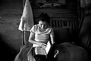 Aura Norori Martínez reads the bible in the living room of her home in Tejarcillos, San Jose. Aura came to Costa Rica 17 years ago from Nicaragua with one of her 3 children Laura. The others followed soon after. Presently 3 out of her 4 children are living in Costa Rica, all in the slum of Tejarcillos. In 2007 Aura was diagnosed with Breast Cancer. Because she has a Costa Rican visa and the socialized healthcare system she could receive free treatments she would never have been able to afford without. Aura did eventually beat the disease. Many immigrants who have not gotten their documents in order must go without healthcare because the government system will not cover them.