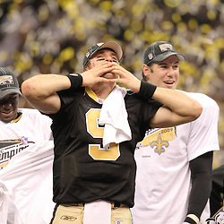 Jan 24, 2010; New Orleans, LA, USA; New Orleans Saints quarterback Drew Brees (9) blows a kiss to the crowd as he celebrates an overtime victory over the Minnesota Vikings in the 2010 NFC Championship game at the Louisiana Superdome. Mandatory Credit: Derick E. Hingle-US PRESSWIRE