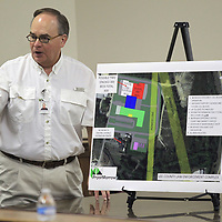 Rud Robison. with Pryor and Morrow Architects, explains the plan and layout of the proposed site of a new Lee County Law Enforcement Complex during a public hearing held Tuesday night at the Lee County Justice Center in Tueplo.