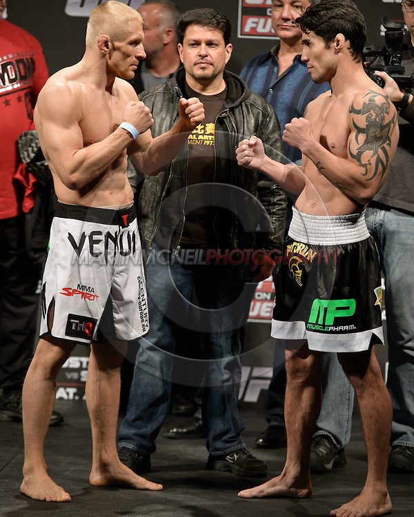 "STOCKHOLM, SWEDEN, APRIL 13, 2012: Dennis Siver (left) and Diego Nunes face off at the weigh-in for ""UFC on Fuel TV: Gustafsson vs. Silva"" inside the Ericsson Globe Arena, Stockholm."