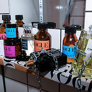 NLD/Amsterdam/20130314 - 1 jarig bestaan magazine Voque Nederland , parfumflesjes aan ketting