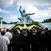 NAGASAKI, JAPAN - AUGUST 9 : People pray for the atomic bomb victims in front of the Nagasaki Peace Park in Nagasaki, southern Japan, Tuesday, August 9, 2016. Japan marked the 71st anniversary of the atomic bombing on Nagasaki. On August 9, 1945, during World War II, the United States dropped the second Atomic bomb on Nagasaki city, killing an estimated 40,000 people which ended World War II. (Photo by Richard Atrero de Guzman/NURPhoto)