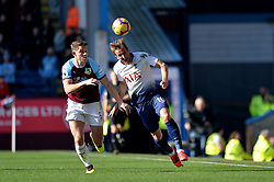 Tottenham Hotspur's Harry Kane and Burnley's James Tarkowski compete for possession