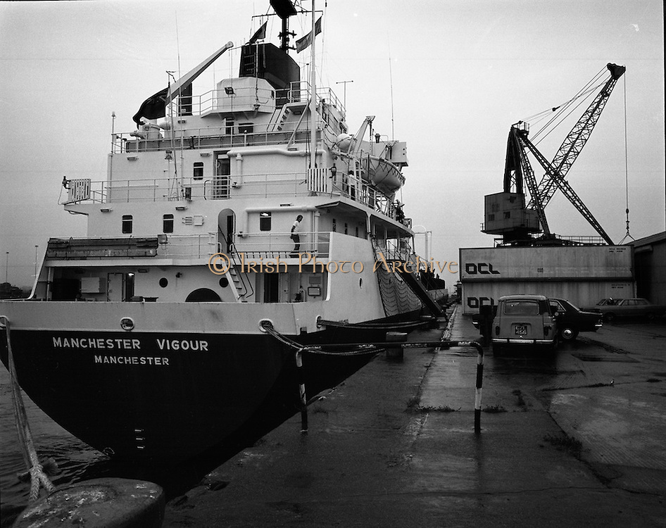 """""""Manchester Vigour""""docks in Dublin.   (F37).1973..16.07.1973..07.16.1973..16th July 1973..En-route from Canada the """"Manchester Vigour""""was intercepted by the Irish Naval Service as she was suspected of carrying weapons for dissident groups in the North of Ireland..The """"Manchester Vigour""""is pictured docked at Dublin Port where she will be searched by the security forces."""
