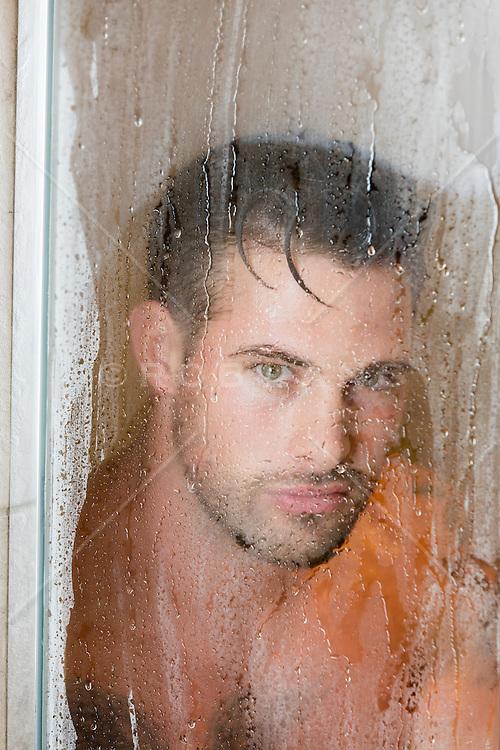 rugged man in a steamy shower