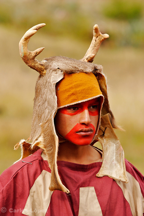 A YOUNG MAN DRESSED WITH THE FUR OF A DEER AND MAKE UP IN HIS FACE READY FOR A  TRADITIONAL DANCE AT THE HATUN LUYA FESTIVAL, .   The Hatun Luya is a festival celebrated every september 13th, where everyone from the surrounding areas comes together. During this festivity, you can witness demonstrations of popular customs.
