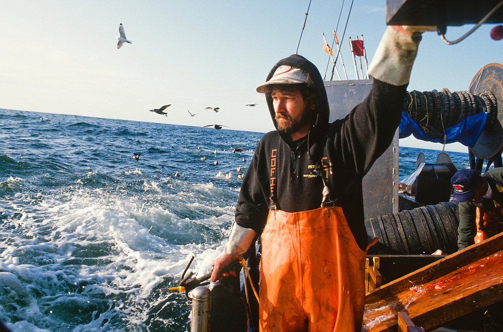 Alaska. Kodiak. Steve Davis (MR) halibut fishing near Kodiak.