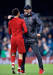 LONDON, ENGLAND - Sunday, March 17, 2019: Liverpool's manager Jürgen Klopp embraces Trent Alexander-Arnold after the FA Premier League match between Fulham FC and Liverpool FC at Craven Cottage. (Pic by David Rawcliffe/Propaganda)