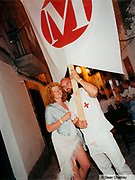 Claire and Mike, Owners of Manumission carrying a sign advertising the club Ibiza 2000