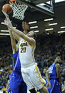 December 17, 2011: Iowa Hawkeyes forward Andrew Brommer (20) puts up a shot as Drake Bulldogs forward Jeremy Jeffers (10) defends during the the NCAA basketball game between the Drake Bulldogs and the Iowa Hawkeyes at Carver-Hawkeye Arena in Iowa City, Iowa on Saturday, December 17, 2011. Iowa defeated Drake 82-68.