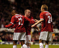 Photo. Jed Wee.Digitalsport<br /> Manchester United v Fenerbahce SK, UEFA Champions League, 28/09/2004.<br /> Manchester United's Wayne Rooney (C) joins in the celebrations after David Bellion's goal.