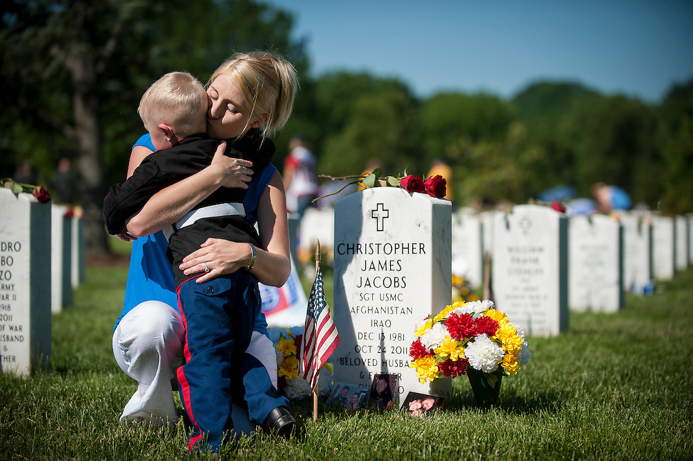 On Memorial Day, Brittany Jacobs of Hertford, North Carolina comforts her son, Christian, 3, at the gravesite of her husband, Marine Sgt. Christopher Jacobs at Arlington National Cemetery in Arlington, Virginia, USA, on 26 May 2014.