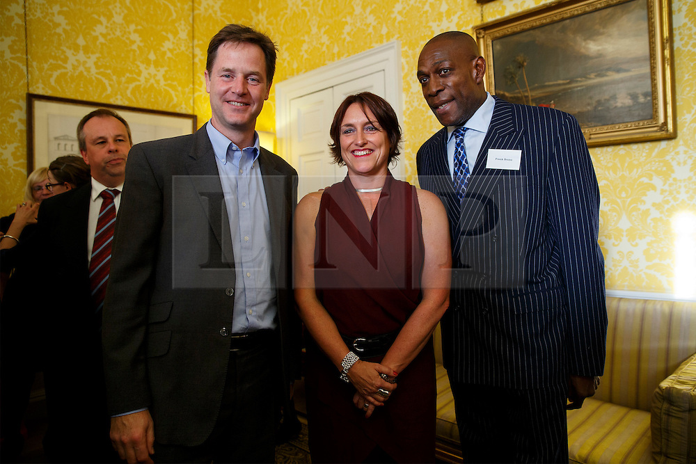 © Licensed to London News Pictures. 10/10/2014. LONDON, UK. Deputy Prime Minister Nick Clegg, Sue Baker and Frank Bruno meeting at a reception for World Mental Health day on Friday, 10 October 2014 at Admiralty House in central London. Photo credit : Tolga Akmen/LNP