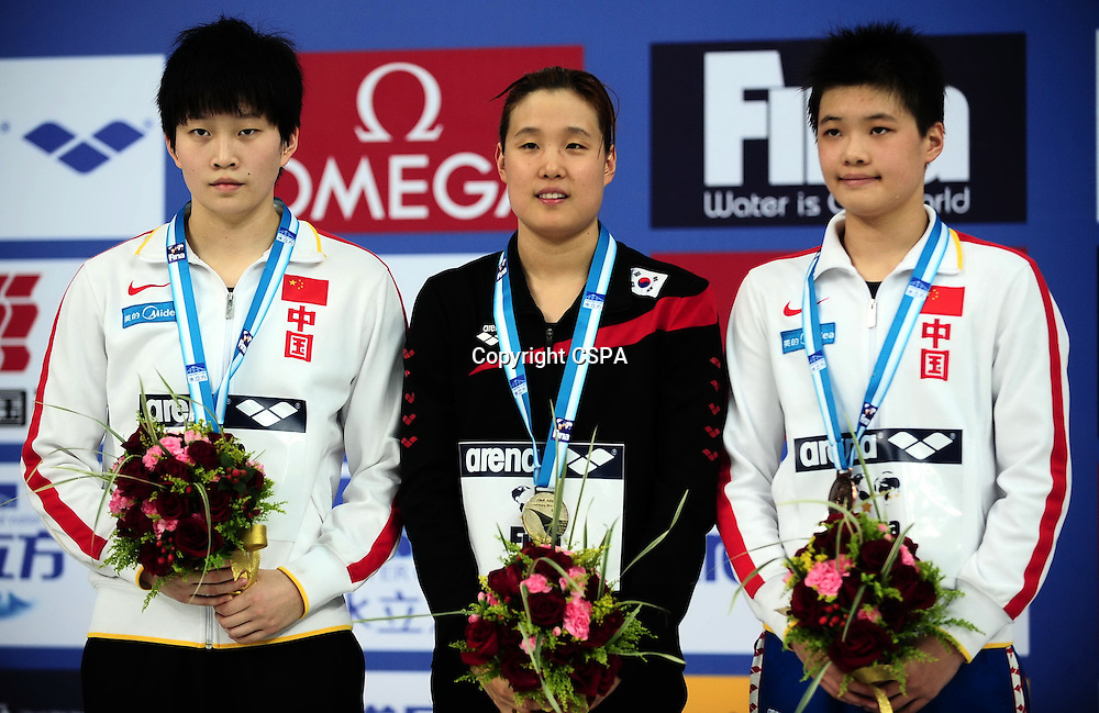 Nov 08, 2011; Beijing, CHINA; (L-R) Li Jiaxing of China, Choi Hye Ra of Korea and Zhou Min of China get silver, gold and bronze medal in the final of Women's 200m Individual Medley on day one of the FINA/ARENA Swimming World Cup 2011 at the National Aquatics Center.