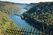 Hawks Nest State Park is located in Fayette County near Ansted, West Virginia, USA. The park's clifftop overlook along U.S. Route 60 provides a scenic vista of the New River, some 750 feet (230 meters) below. The area is named for the Osprey that once nested in the cliffs. The Hawks Nest Dam seen just below the overlook was built to provide water for a hydroelectric plant to generate power for an electro-metallurgical plant at the town of Alloy, and dates to the 1930's. The tragic Depression-era Hawk's Nest incident: Construction of the tunnel, diverting waters of New River through Gauley Mt for hydroelectric power, resulted in West Virginia's worst industrial disaster. Silica rock dust caused 109 admitted deaths in the mostly black, migrant underground work force of 3,000. A Congressional hearing placed the death toll at 476 for the period from 1930 through 1935. The tragedy brought recognition of acute silicosis as an occupational lung disease, and compensation legislation to protect workers.