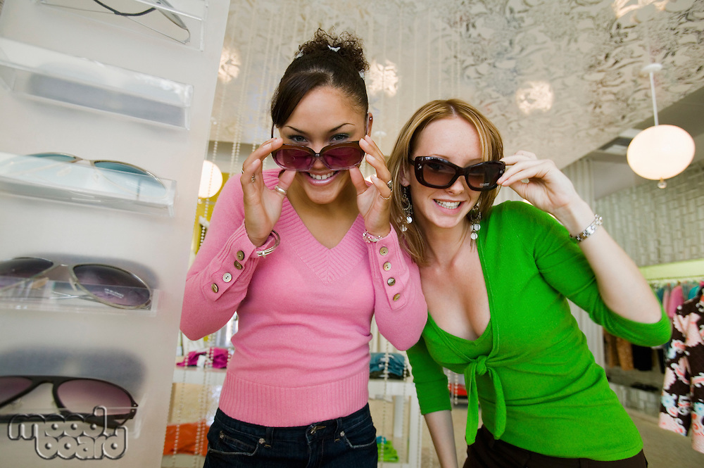 Girls Trying on Sunglasses in Boutique