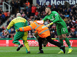Stoke City's Jack Butland helps a steward tackle a pitch invader - Photo mandatory by-line: Dougie Allward/JMP - Mobile: 07966 386802 - 09/05/2015 - SPORT - Football - Stoke - Britannia Stadium<br />  - Stoke v Tottenham Hotspur - Barclays Premier League