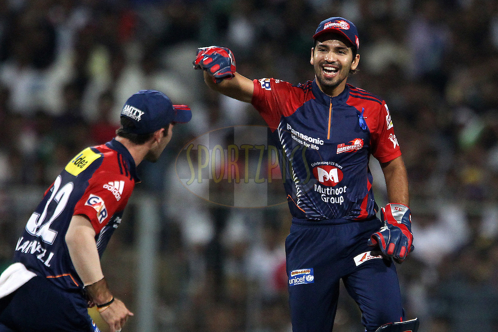 Naman celebrates running out Debabrata Das during match 2 of the the Indian Premier League ( IPL) 2012  between The Kolkata Knight Riders and The Delhi Daredevils held at the Eden Gardens Stadium in Kolkata on the 5th April 2012..Photo by Ron Gaunt/IPL/SPORTZPICS