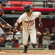 15 April 2018: San Diego State outfielder Chase Calabuig (34) hits an rbi double to left field to give the Aztecs a 2-0 lead in the bottom of the first over the Titans. The San Diego State baseball team closed out the weekend series against Cal State Fullerton with a 9-6 win at Tony Gwynn Stadium. <br /> More game action at sdsuaztecphotos.com