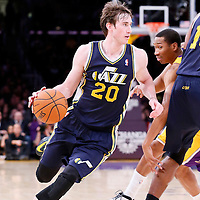 11 February 2014: Utah Jazz shooting guard Gordon Hayward (20) drives past Los Angeles Lakers small forward Wesley Johnson (11) during the Utah Jazz 96-79 victory over the Los Angeles Lakers at the Staples Center, Los Angeles, California, USA.