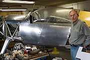 Bjorn Thoroddson of the Thoroddson family, standing next to a private airplane he is building in his home workshop in Hafnarfjordur near Reykjavik, Iceland. The Thoroddsons were originally photographed in 1993 for the book Material World, but are seen here in 2004 on a revisit. MODEL RELEASED..
