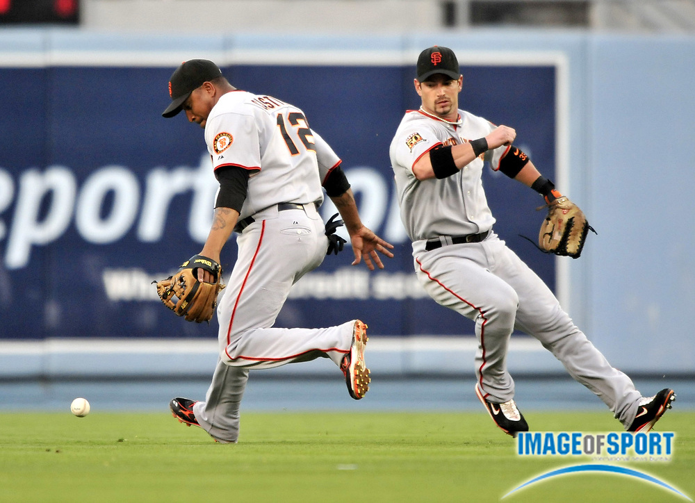Jul 30, 2008; Los Angeles, CA, USA; San Francisco Giants second baseman Jose Castillo (12) bobbles a fly ball as center fielder Aaron Rowand (33) closes in during the game against the Los Angeles Dodgers at Dodger Stadium. Mandatory Credit: Kirby Lee/Image of Sport-US PRESSWIRE