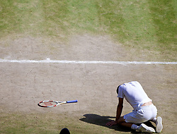 04.07.2014, All England Lawn Tennis Club, London, ENG, ATP Tour, Wimbledon, im Bild Grigor Dimitrov (BUL) falls during the Gentlemen's Singles Semi-Final match on day eleven // during the Wimbledon Championships at the All England Lawn Tennis Club in London, Great Britain on 2014/07/04. EXPA Pictures © 2014, PhotoCredit: EXPA/ Propagandaphoto/ David Rawcliffe<br /> <br /> *****ATTENTION - OUT of ENG, GBR*****