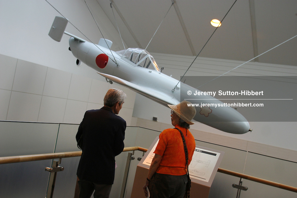 """'OHKA' SPECIAL ATTACK PLANE-'CHERRY BLOSSOM' ON DISPLAY AT YASUKUNI-JINJA SHRINE, TOKYO.  This kamikaze plane was used against US forces in the battle for Okinawa. Yasukuni Shrine is home to the spirits of the Japanese WWII war dead including """"kamikaze' pilots who all agreed to meet there in the """"afterlife"""", beside the second cherry blossom tree on the right as you enter the shrine.. Shrine is controversially visited by Prime Minister Koizumi each year."""