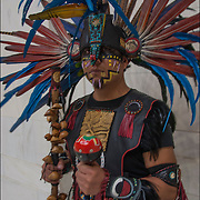 Portrait of Naz Cruz is a dancer in Danza Mexikah, the image  taken after ceremonial dance on the Day of the Dead on the rotunda in the National Museum of the American Indians.<br />