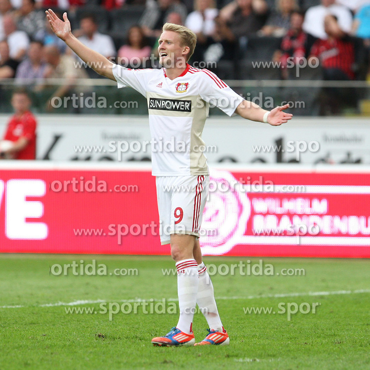25.08.2012, Commerzbank Arena, Frankfurt, GER, 1. FBL, Eintracht Frankfurt vs Bayer 04 Leverkusen, 1. Runde, im Bild Andre SCHUERRLE (Bayer 04 Leverkusen) moniert den Abseitspfiff..Torwart Kevin Trapp (Frankfurt) hat den Ball sicher // during the German Bundesliga 1st round match between Eintracht Frankfurt and Bayer 04 Leverkusen at the Commerzbank Arena, Frankfurt, Germany on 2012/08/25. EXPA Pictures © 2012, PhotoCredit: EXPA/ Eibner/ Bildpressehaus..***** ATTENTION - OUT OF GER *****