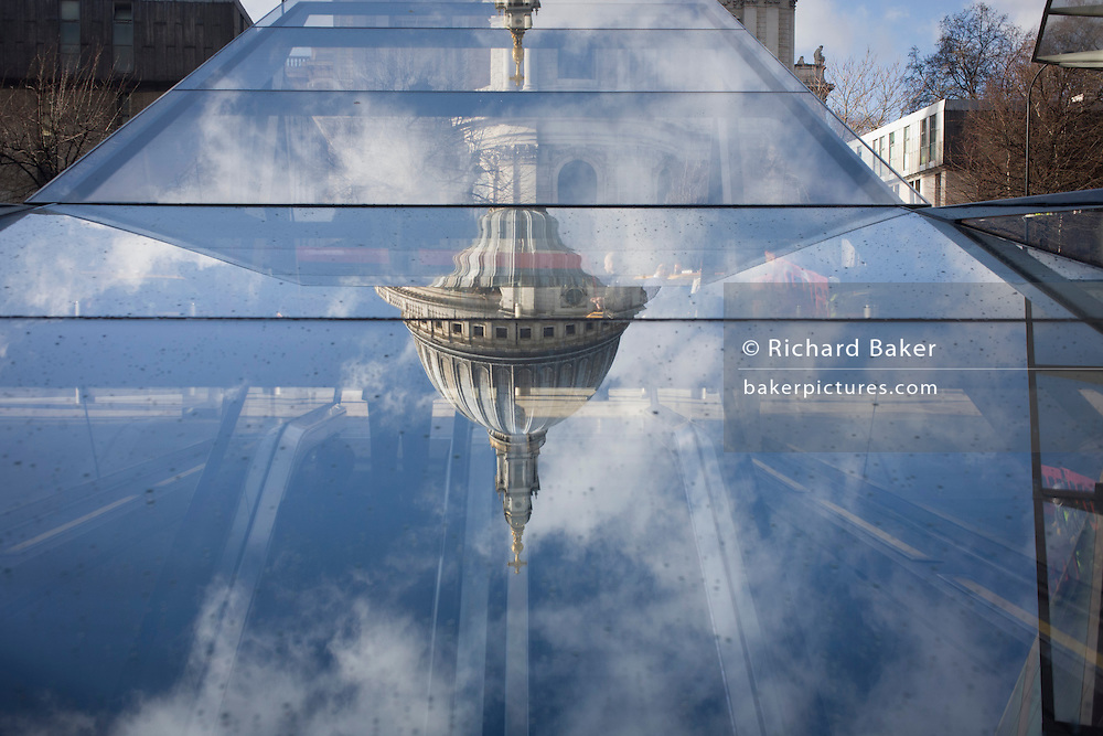 An unusual view of St Paul's Cathedral, seen reflected in a nearby shopping mall roof in the financial City of London.
