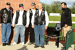 14 May 2016: members of the Rolling Thunder with CornBelters Jeff Holtke dedicate an unoccupied chair with respect to all American MPO's and MIA's during a Frontier League Baseball game between the Joliet Slammers and the Normal CornBelters at Corn Crib Stadium on the campus of Heartland Community College in Normal Illinois