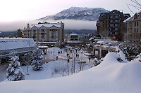 Whistler Village is quiet and calm after a fresh snowfall on a winter evening.