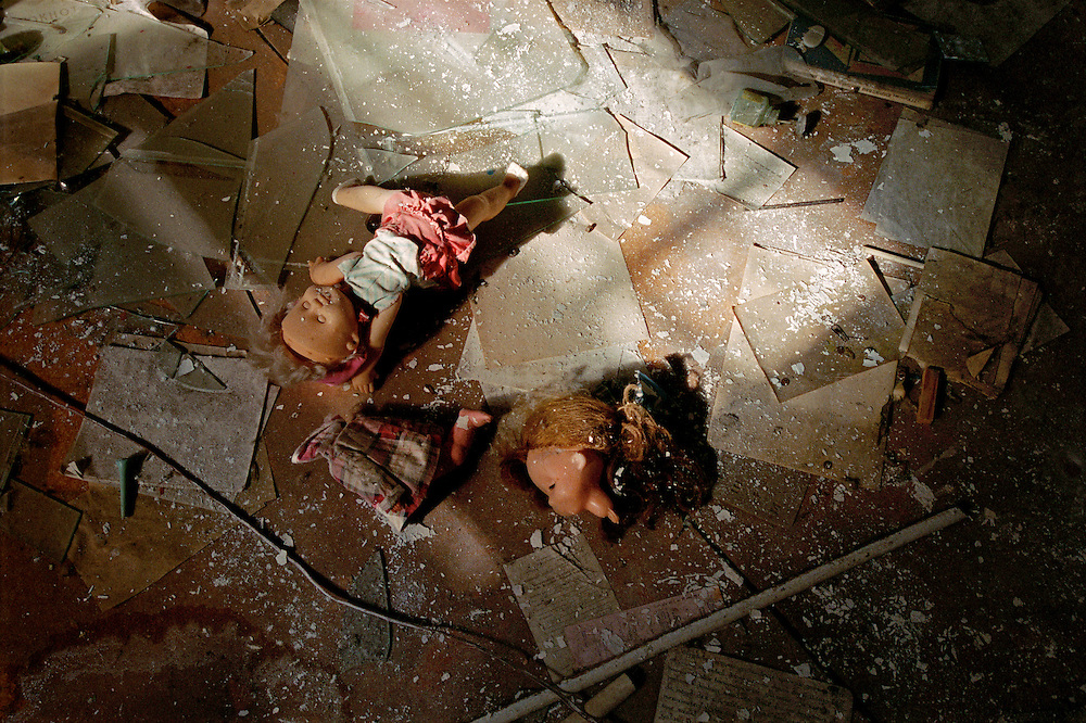 Chernobyl Legacy. ..Ukraine 2001...Dolls, paper and broken glass on the floor in a former kindergarden in the abandoned city of Prypiat. ..This used to be the city were all the workers in Chernobyl lived. After the accident it was evacuated...Photo: Markus Marcetic/MOMENT..