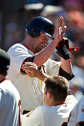 May 30, 2010; San Francisco, CA, USA;  San Francisco Giants first baseman Aubrey Huff (17) is congratulated by teammates after hitting a one run home run against the Arizona Diamondbacks during the eighth inning at AT&T Park.