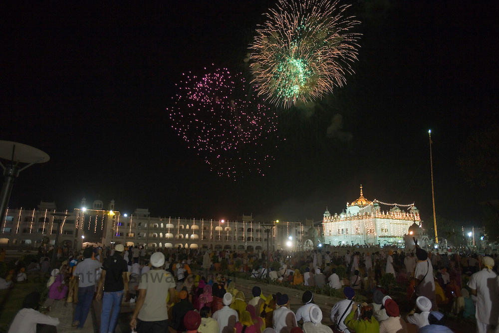 .Fireworks light the night sky at the Satkhand gurudwara on the occasion of the 300th year of the consecration of the perpetual Guru of the Sikh faith, the Guru Granth Sahib, in Nanded, 650 kms south of Mumbai on October 30, 2008. Sikhs all over the world are celebrating the 300th year of the consecration of their perpetual Guru, the Guru Granth Sahib.