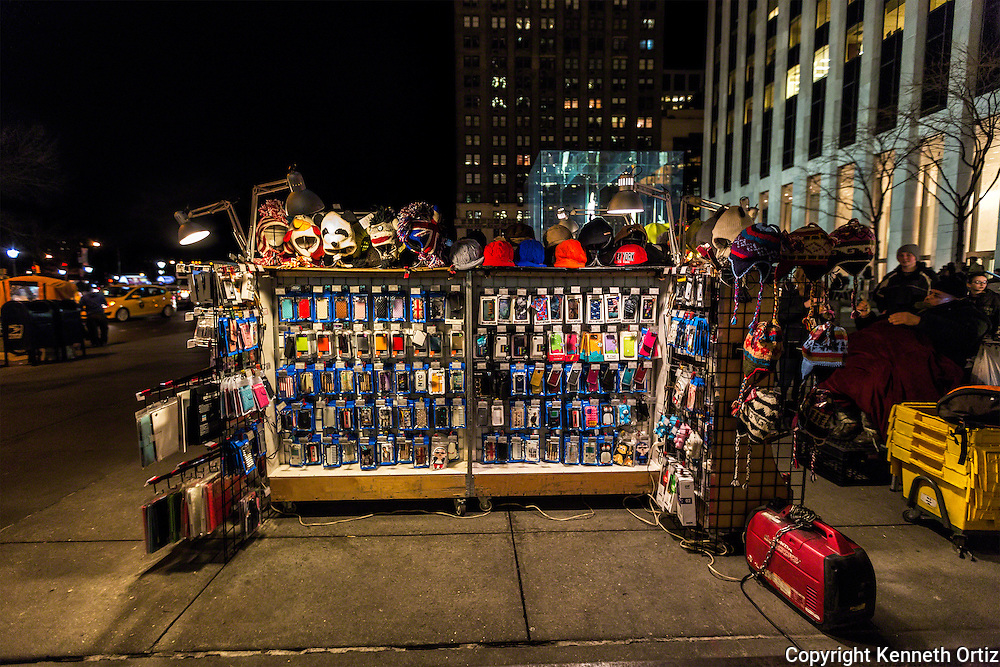A street vendor on the corner of 58th And 5th Avenue next door to the Mac Store.
