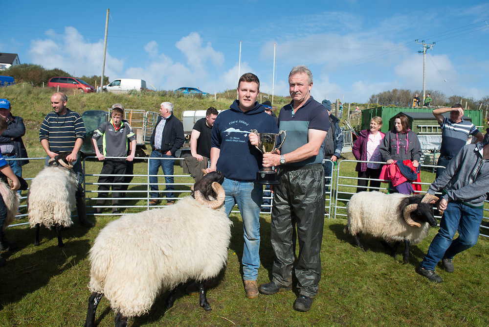 Clare Island Ram Fair &amp; Sheep Dog Trials.<br /> Judge James Lally presents the Mikey Paddy O'Malley memorial cup to Brian O'Malley who won the hogget blackface Ram catagory. Pic: Michael Mc Laughlin