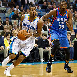 January 24,  2011; New Orleans, LA, USA; New Orleans Hornets small forward Trevor Ariza (1) drives past Oklahoma City Thunder small forward Kevin Durant (35) during the first quarter at the New Orleans Arena. Mandatory Credit: Derick E. Hingle