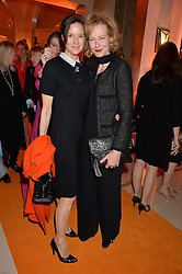 Left to right, ELIZABETH PEYTON-JONES and JULIA PEYTON-JONES at the Veuve Clicquot Business Woman Awards held at Claridge's, Brook Street, London on 11th May 2015.