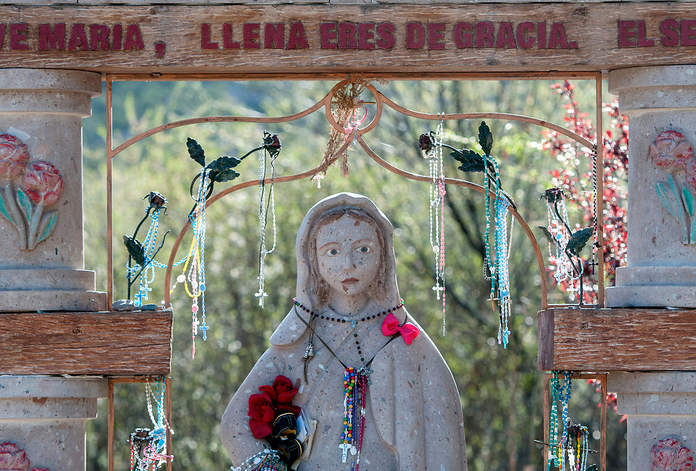 em041417g/a/One of the Stations of the Cross behind the Santuario de Chimayo, Friday April 14, 2017. With beautiful weather, thousands of people were making the Good Friday pilgrimage to the Northern New Mexico church.  (Eddie Moore/Albuquerque Journal